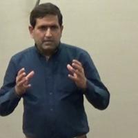 Photo of Nasir Speaking