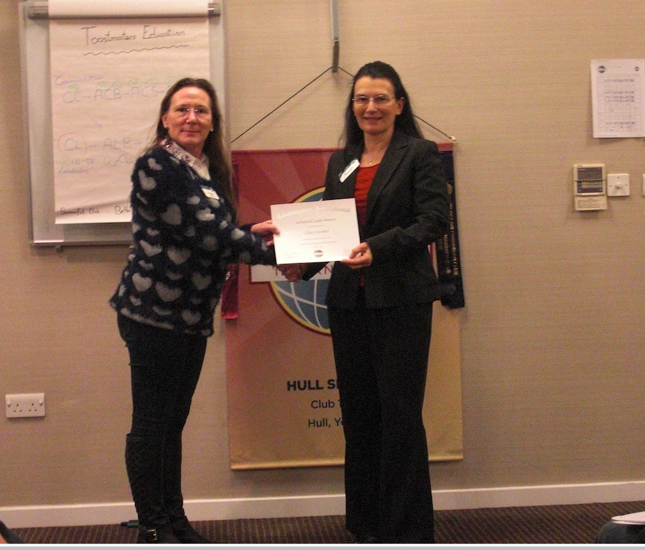 Former club President, Pauline Westrop, awarding Clare Crowther and advanced speaking certificate.
