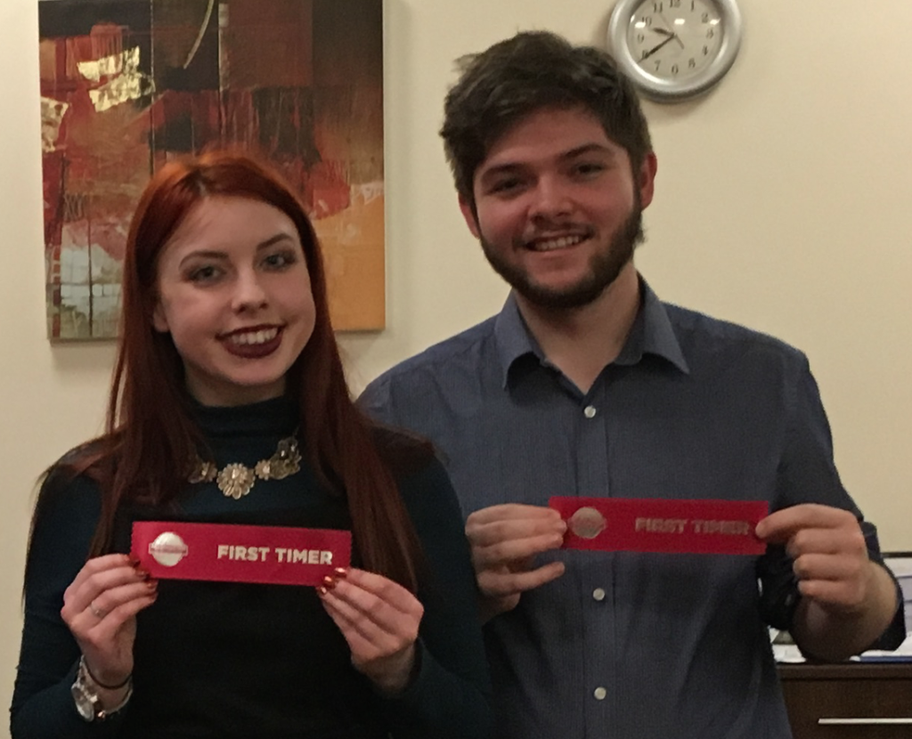 Toastmasters Jessie and Adam receiving their first time speaker awards